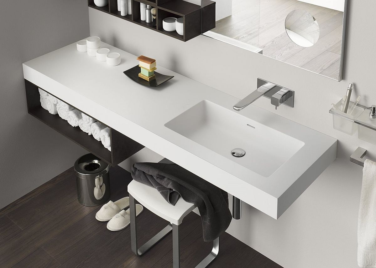 Sleek laminate finishes allow the vanity and cabinets to complement one another elegantly