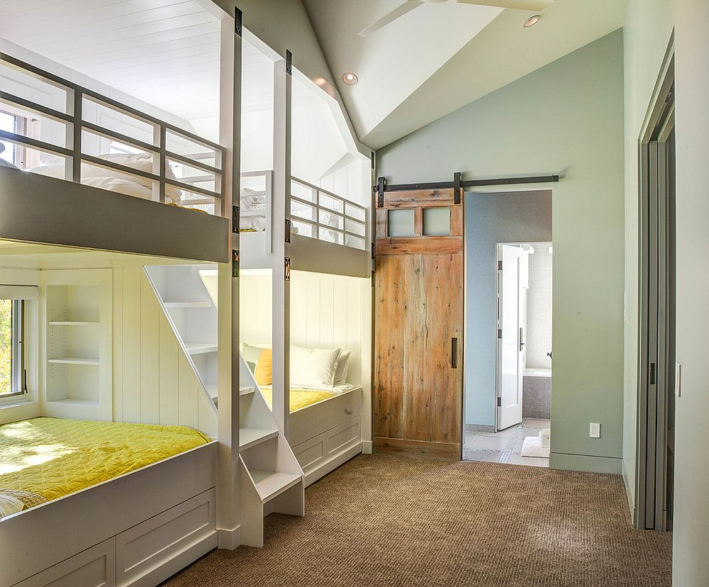 Sliding barn door in the kids' room with wall of bunk beds is a space-saver [Design: Vertical Arts Architecture / Kevin Dietrich Photography]