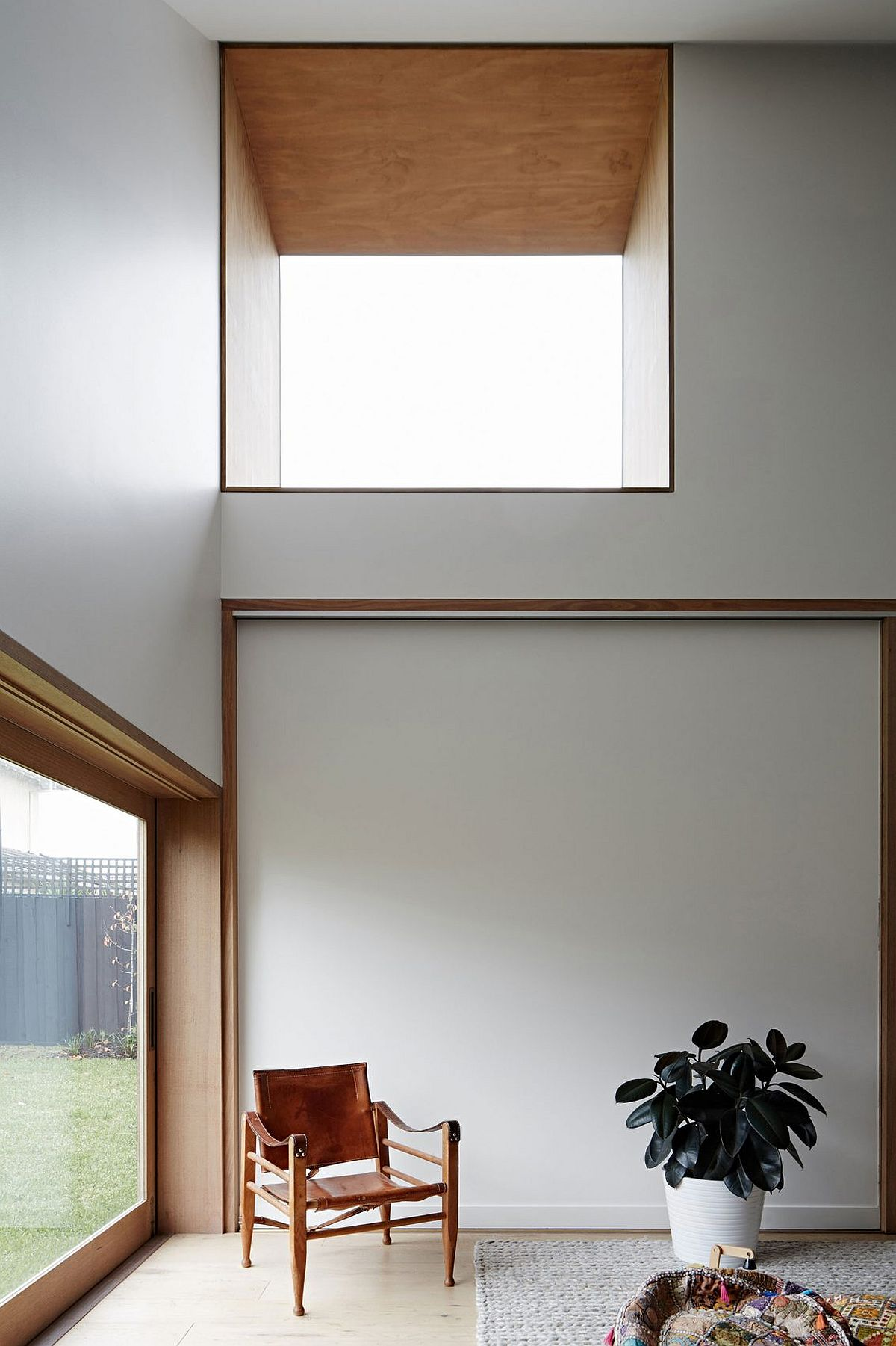 Sliding doors and high windows bring in ample natural light