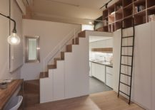 Small-apartment-makes-complete-use-of-vertical-space-on-offer-with-floor-to-ceiling-shelves-217x155