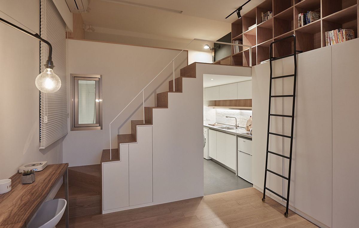 Small apartment makes complete use of vertical space on offer with floor-to-ceiling shelves