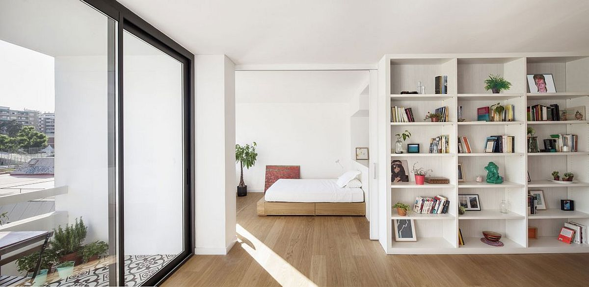 Small balcony and large glass doors bring in plenty of light into the apartment