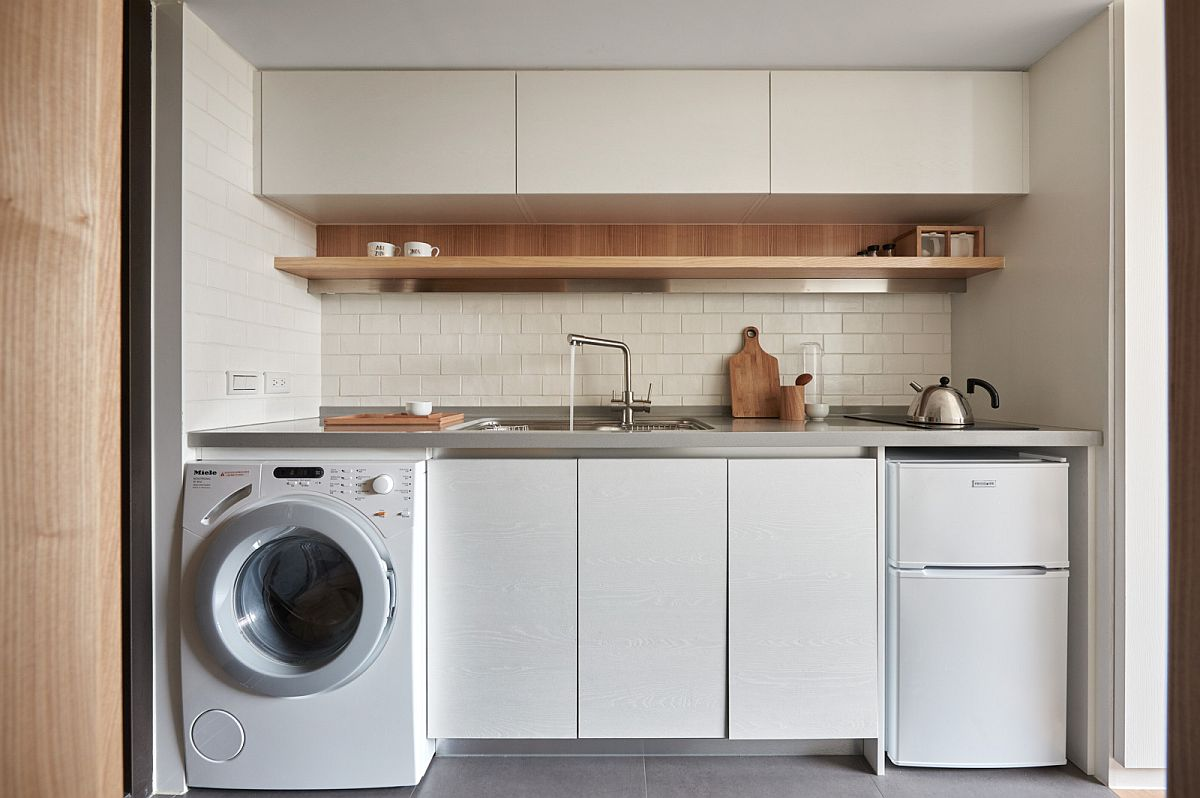 Small kitchen that also serves as a quick laundry space