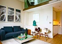 Small-living-room-with-mirrored-coffe-table-and-a-couch-in-bright-blue-217x155