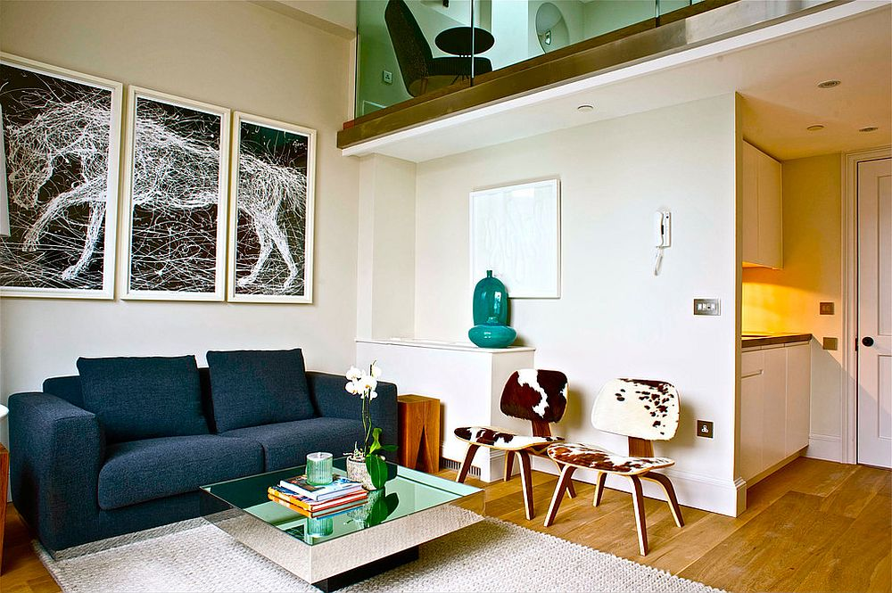 Small living room with mirrored coffe table and a couch in bright blue