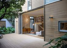 Small living space of the home opens up into the deck outside