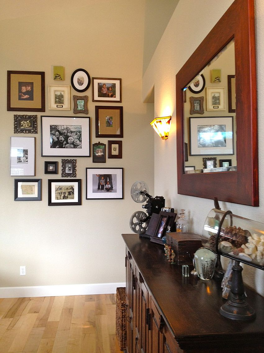 Smart photo collage wall for the eclectic entry [Design: The Vintage Bean]