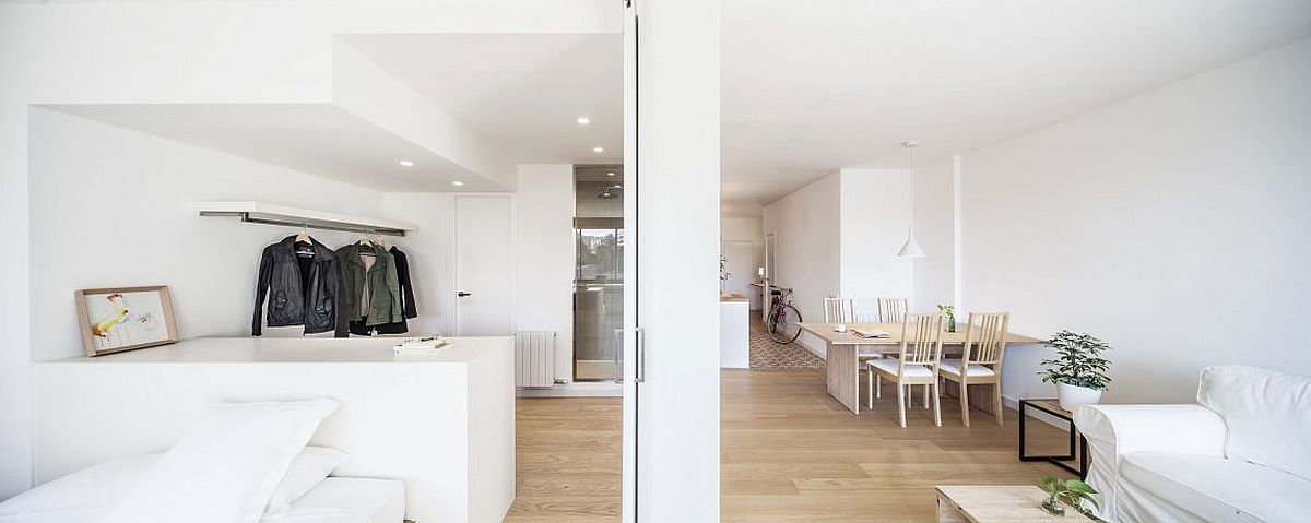 Smart sliding door creates a partition between the bedroom and living area