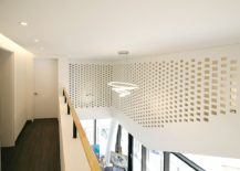 Smart use of mesh style wall to create a flow of natural light