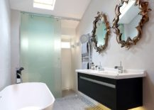 Space-savvy-and-exclusive-master-bathroom-crafted-by-LLI-Design-with-freestanding-bathtub-and-striking-mirrors-above-the-floating-vanity-217x155