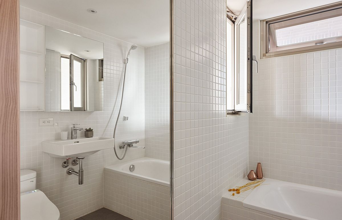 Spacious and light filled bathroom and shower area of the small Taipei apartment