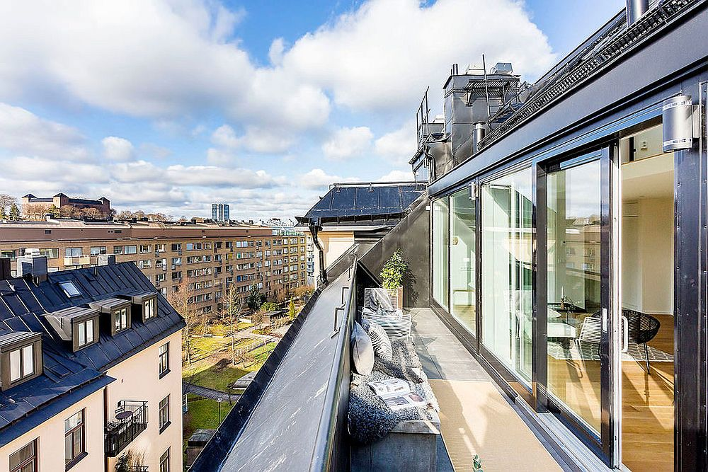 Spacious balcony of the Stockholm apartment with a view of the city skyline