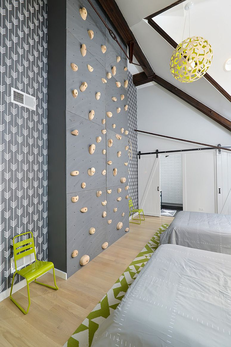 Spacious kids room with climbing wall and sliding doors