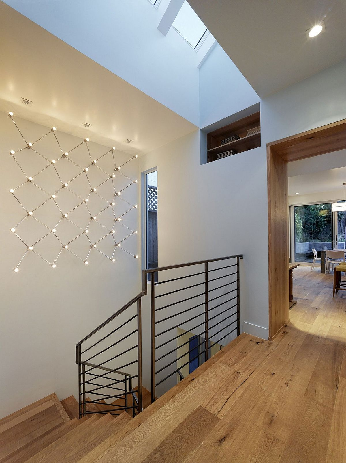 Staircase connects the various levels of the stylish San Francisco home