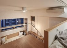 Stairway-with-a-simply-handrail-leads-to-the-mezzanine-level-bedroom-217x155