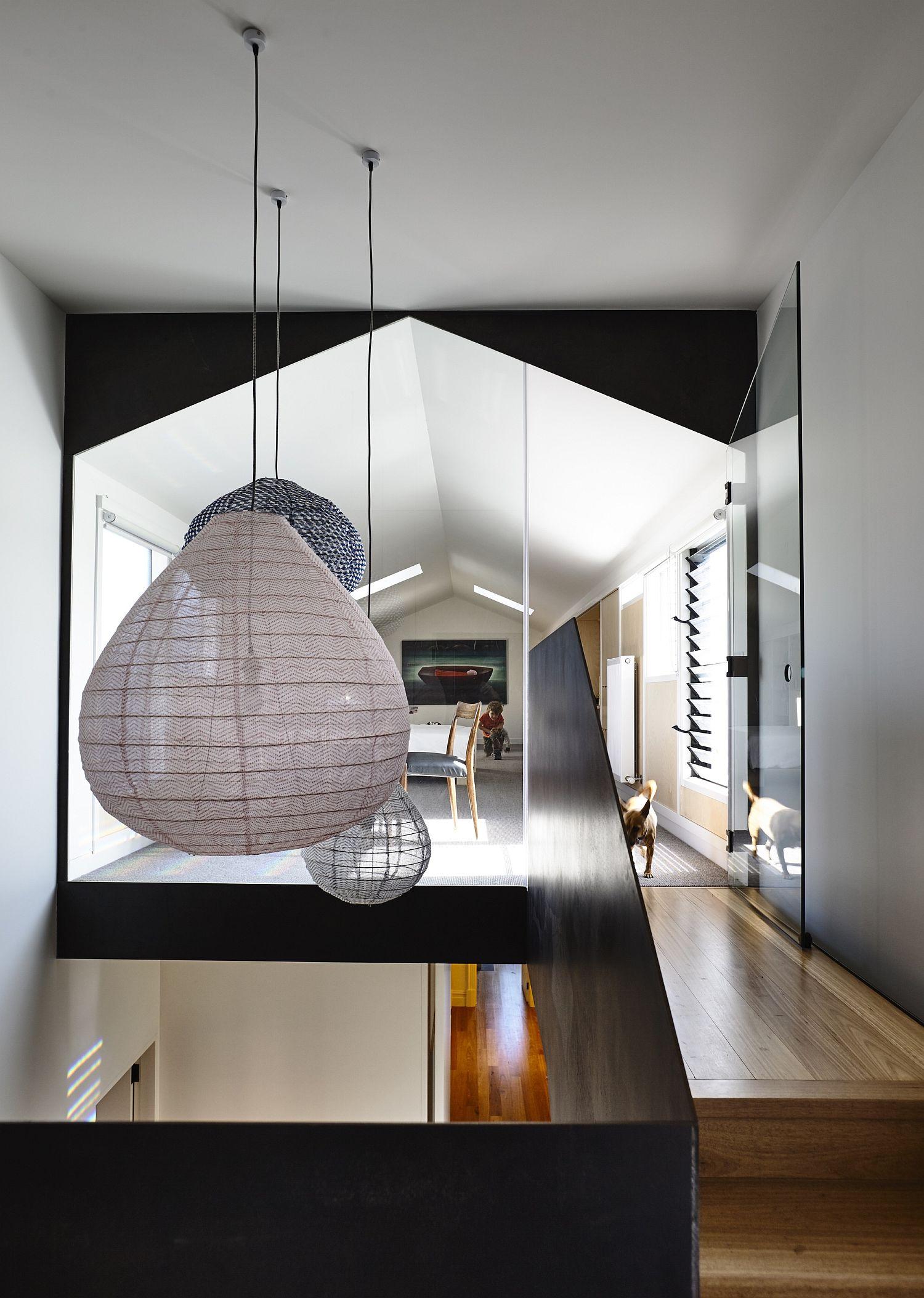 Striking lantern style penfdant lighting for the stairway