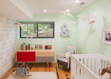 Subtle wallpaper in a mint nursery