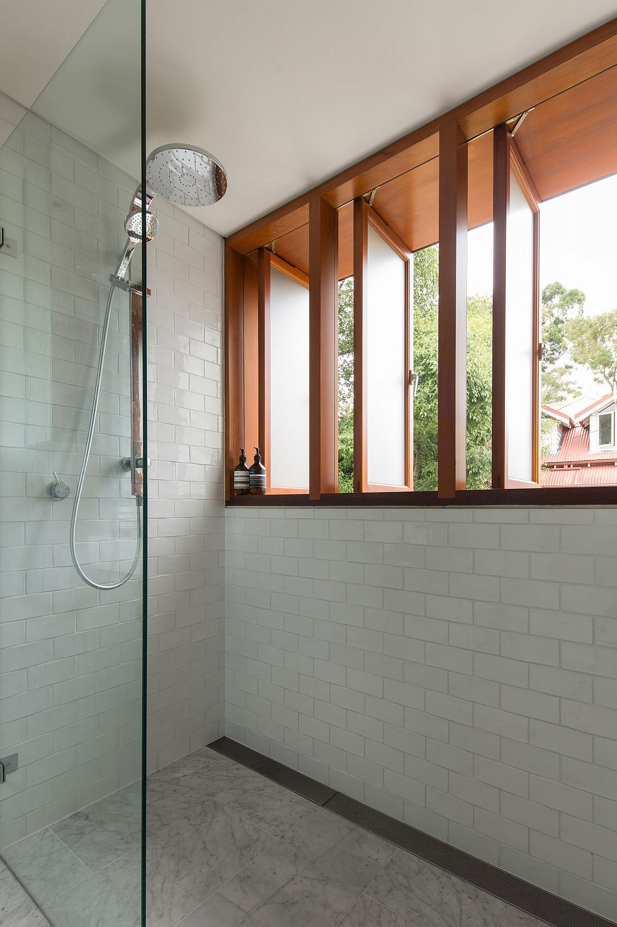 Swiveling windows provide the modern bathroom with necessary ventilation