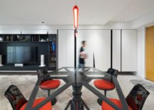 TIE Fighter inspired dining room with matching chiars in black and double-bladed lightsaber chandelier