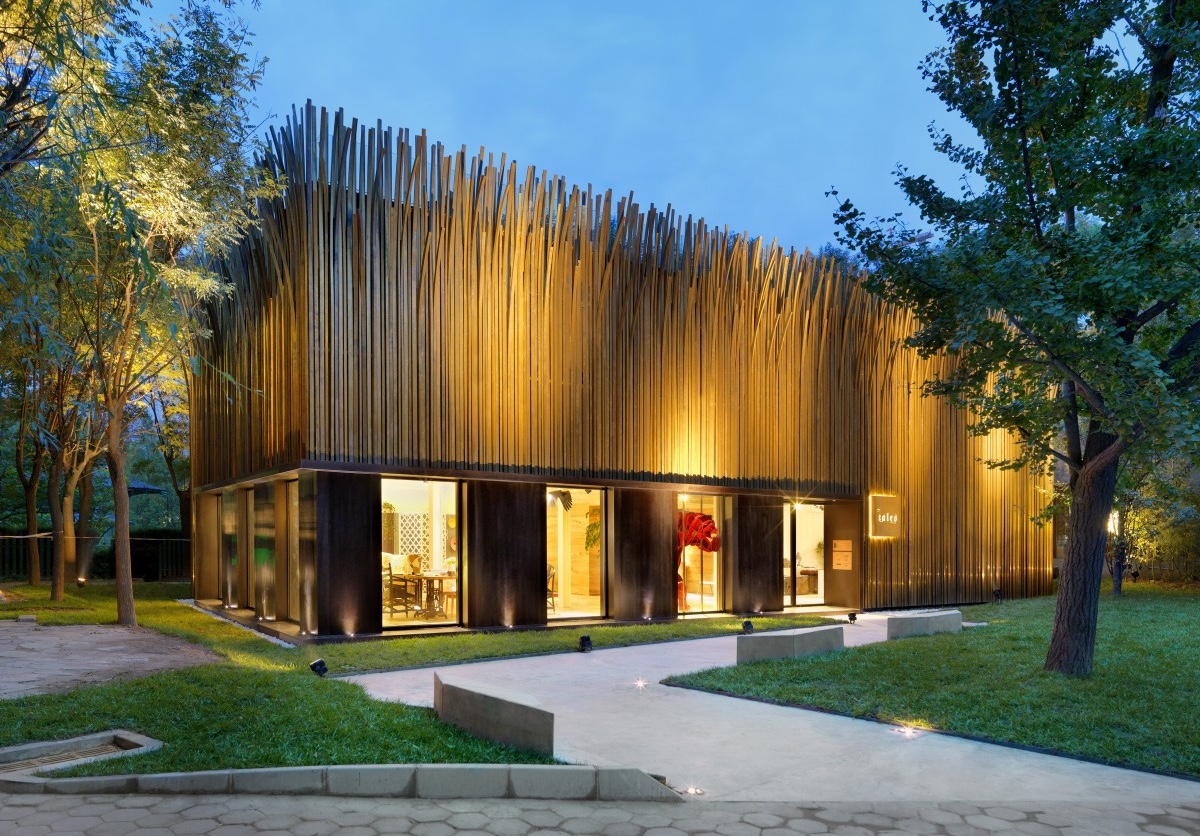 Tales Pavilion for design distributor Tales. This free-standing design showroom in Beijing is Nichetto Studio's first architectural design. The building's facade is covered in 1,200 individual grass-like strands of brass.