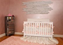 Textured wall in pink gives the shabby chic nursery a hint of rustic beauty