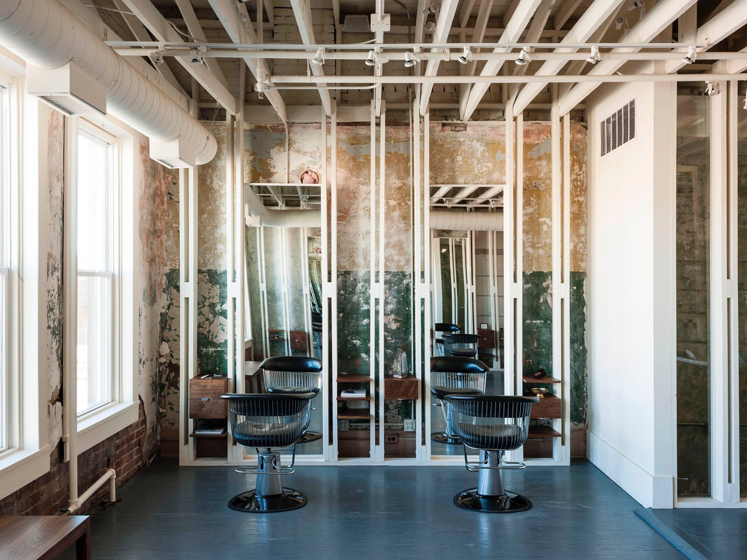 "The First Ward is a salon located in Tulsa, Oklahoma. Housed in a former brothel, the space partly maintains a beautifully decaying interior, the result of its time as a ""house of ill repute""."
