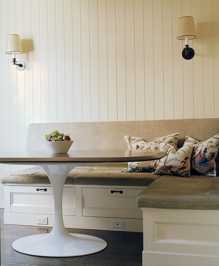 Three storage drawers shape the base of this lovely little banquette in the corner with the Tulip table [Design: Adrienne Neff Design Services]