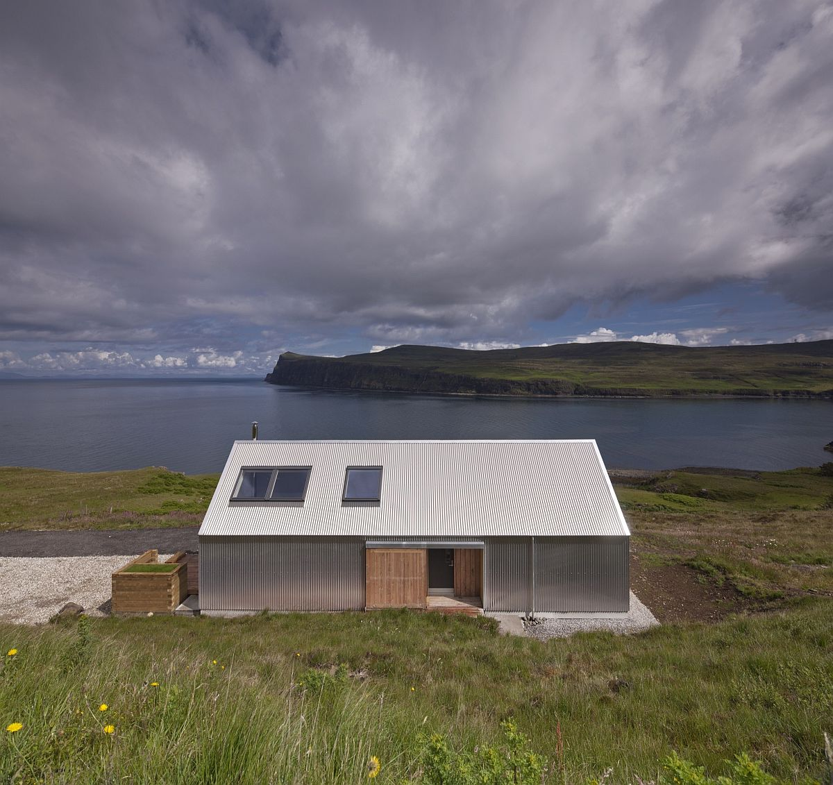 Tinhouse on the Isle of Skye overlooks a lovely natural landscape Serene Residence on Isle of Skye Blends Rural and Modern Aesthetics