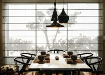 Tom Dixon pendants and stylish midcentury chairs are perfect for the modern Asian dining space