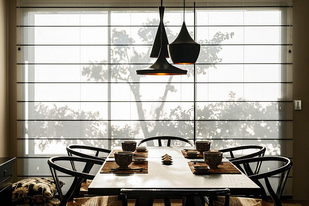 Tom Dixon pendants and stylish midcentury chairs are perfect for the modern Asian dining space [Design: Webb & Brown-Neaves]