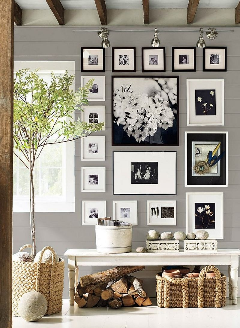 Track lighting is perfect to highlight gallery wall in the entry 25 Captivating Entryways That Embrace the Beauty of the Gallery Wall