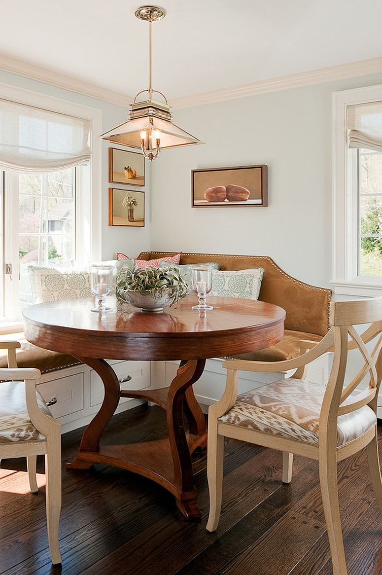 banquette in the kitchen corner with large round wooden table