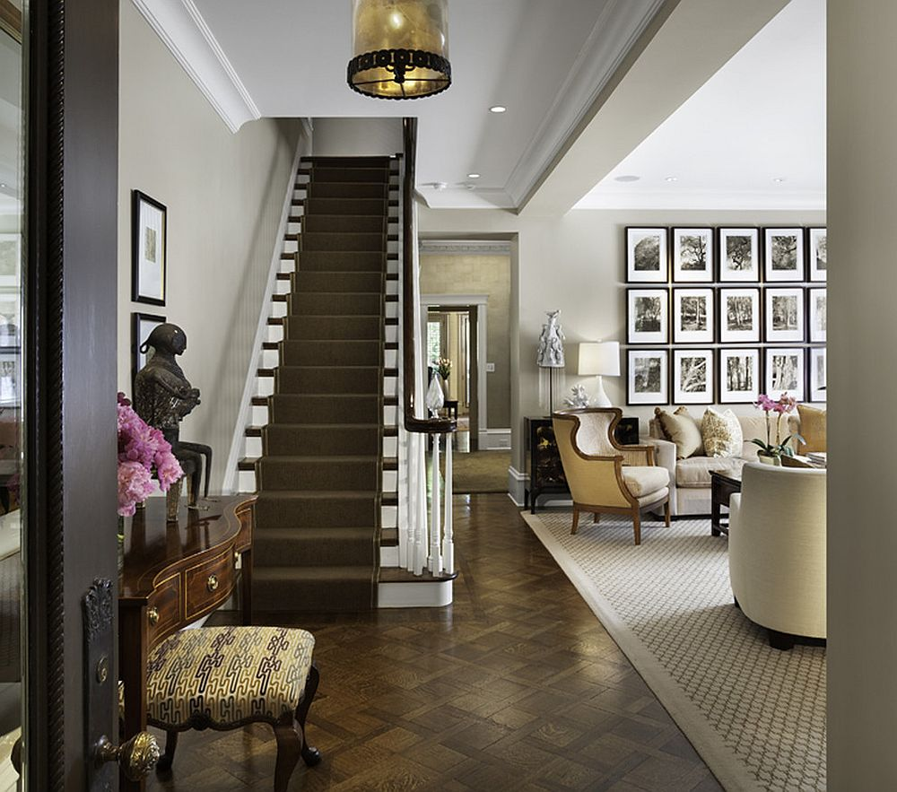 Traditional entry shares a gallery wall with the living room [Design: Rugo/ Raff Ltd. Architects]