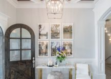 Transitional entry with a lovely little picture wall