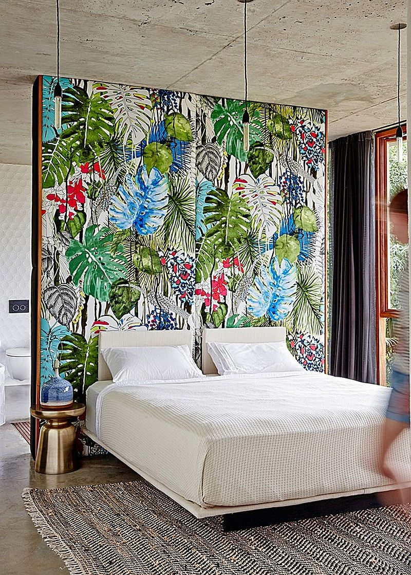Tropical bedroom with a colorful accent wall [Design: eDezeen]