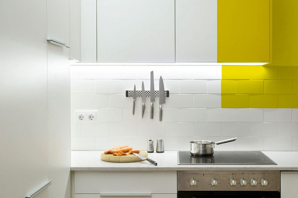 Under cabinet LED strip lightinga nd tiled backdrop for the small kitchen in white