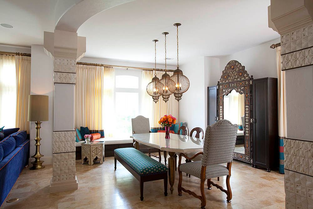 Unique lanterns give the dining room a Moroccan twist [Design: Laura U / Photography: Julie Soefer]
