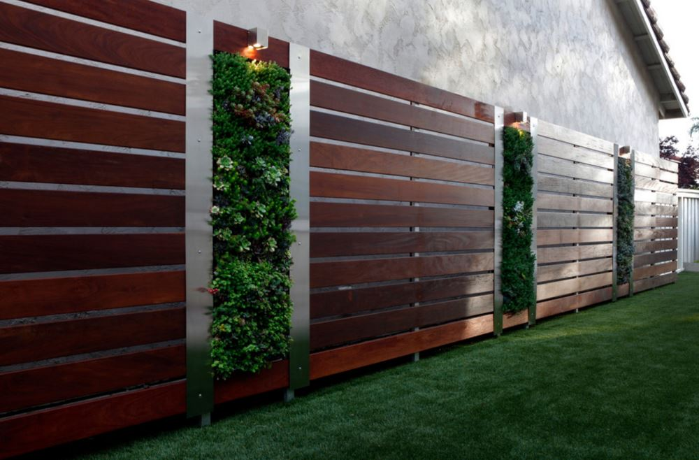 Vertical gardens in a modern fence