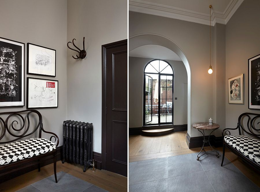 Victorian entry with a simple gallery wall in black and white