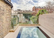 Walk on skylights provide great natural ventilation even while creating outdoor space 217x155 Nifty Extension with Walk On Skylights Enlivens This Terrace House