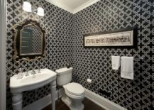 Wallpaper in black white adds elegance to the powder room