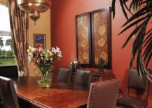 Warm yellow and bright red create a bold backdrop for this Moroccan dining room