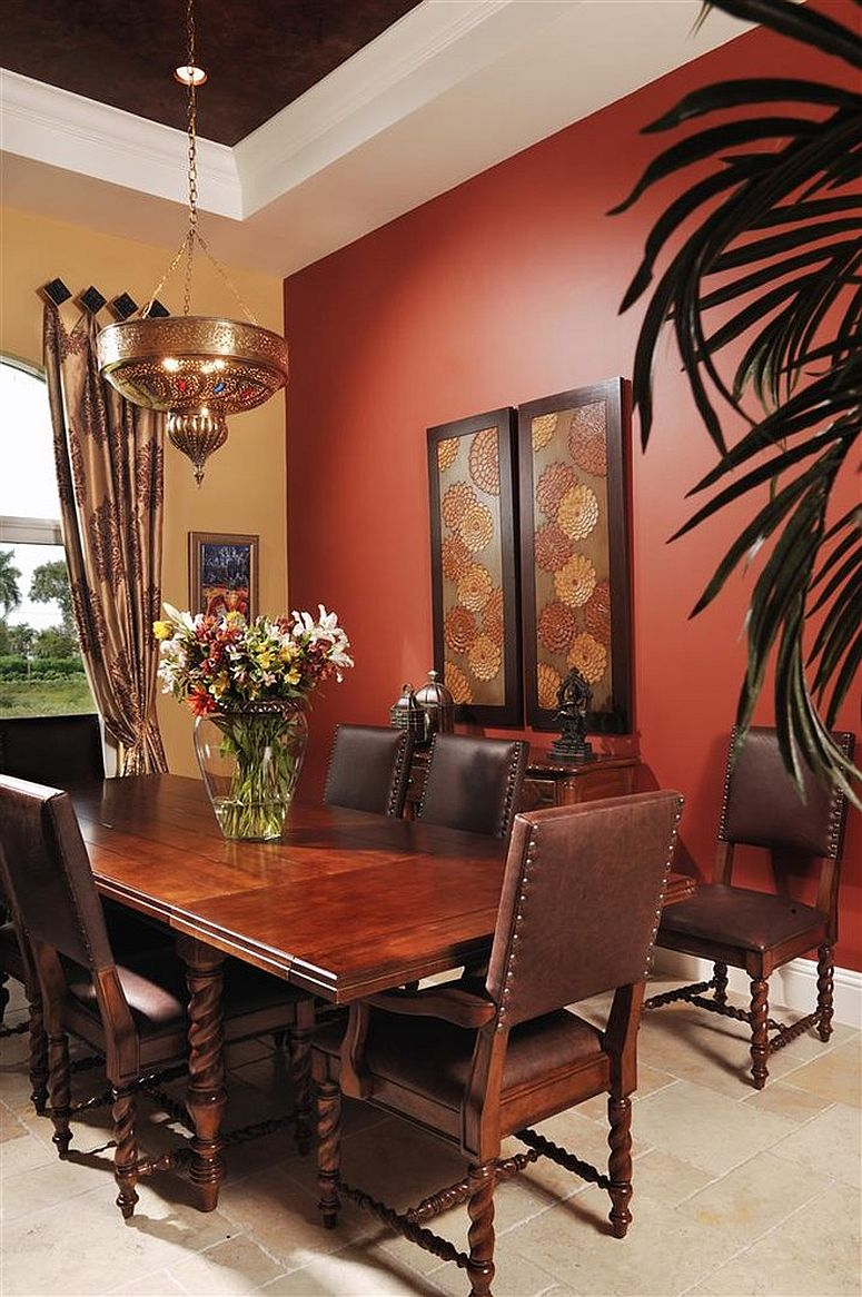 Warm yellow and bright red create a bold backdrop for this Moroccan dining room [From: Interiors by Myriam]