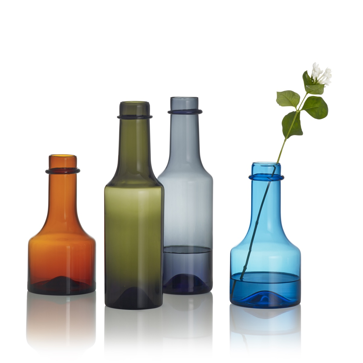 Wirkkala glass bottles. Designed by Tapio Wirkkala and originally produced by Iittala between 1959 and 1968. Image © Fiskars Finland.