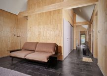 Wooden bricks and minimal style shape the interior of the house