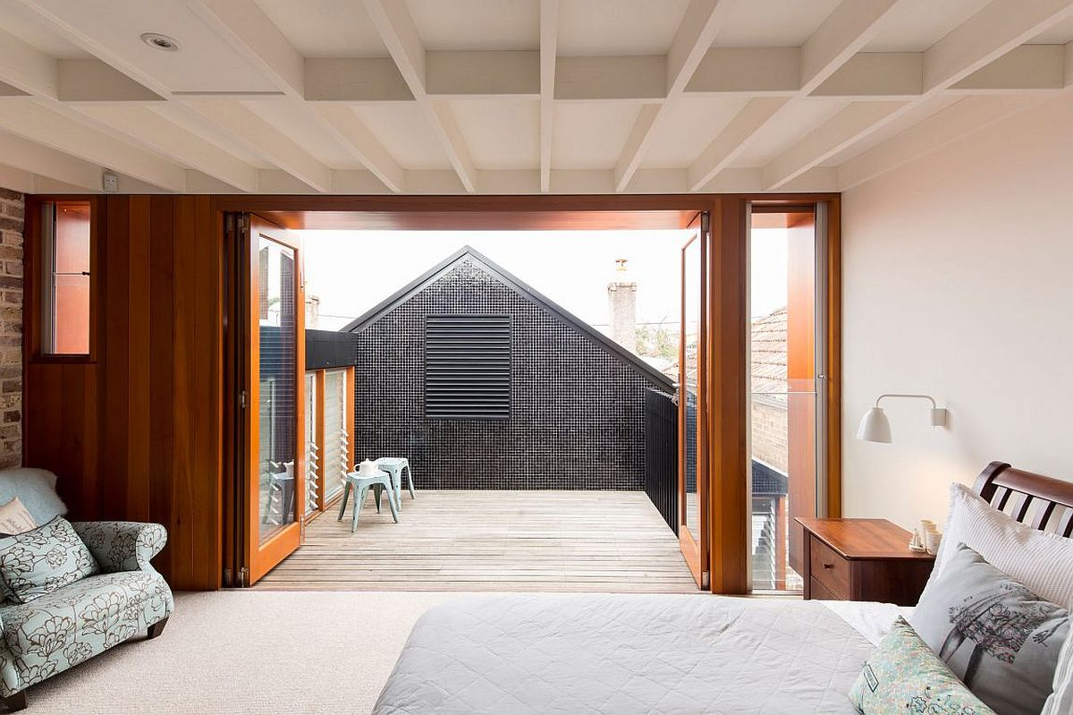 Wooden deck on the top level connected to the master bedroom