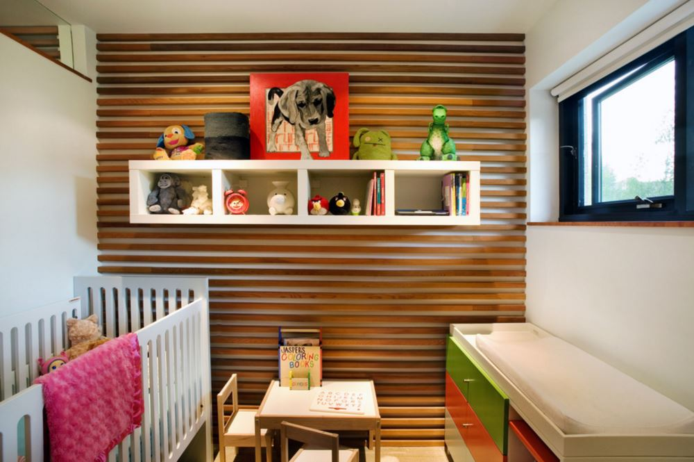 Wooden paneling in a modern nursery