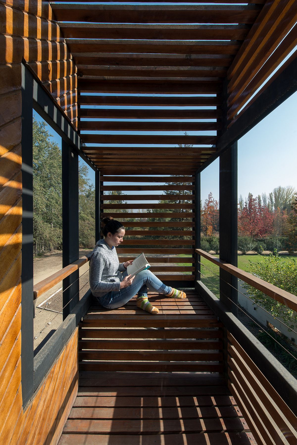 Wooden slat offer the perfect shelter from sunlight even as the home offers stunning views of the lovely landscape