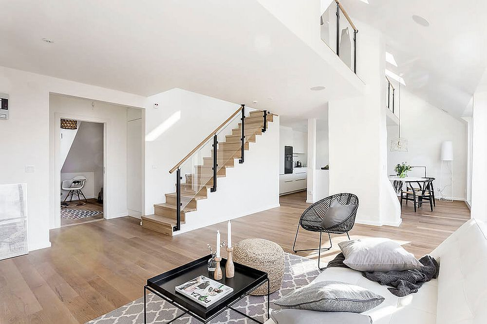 Wooden staircase with glass railing for the modern Scandinavian home