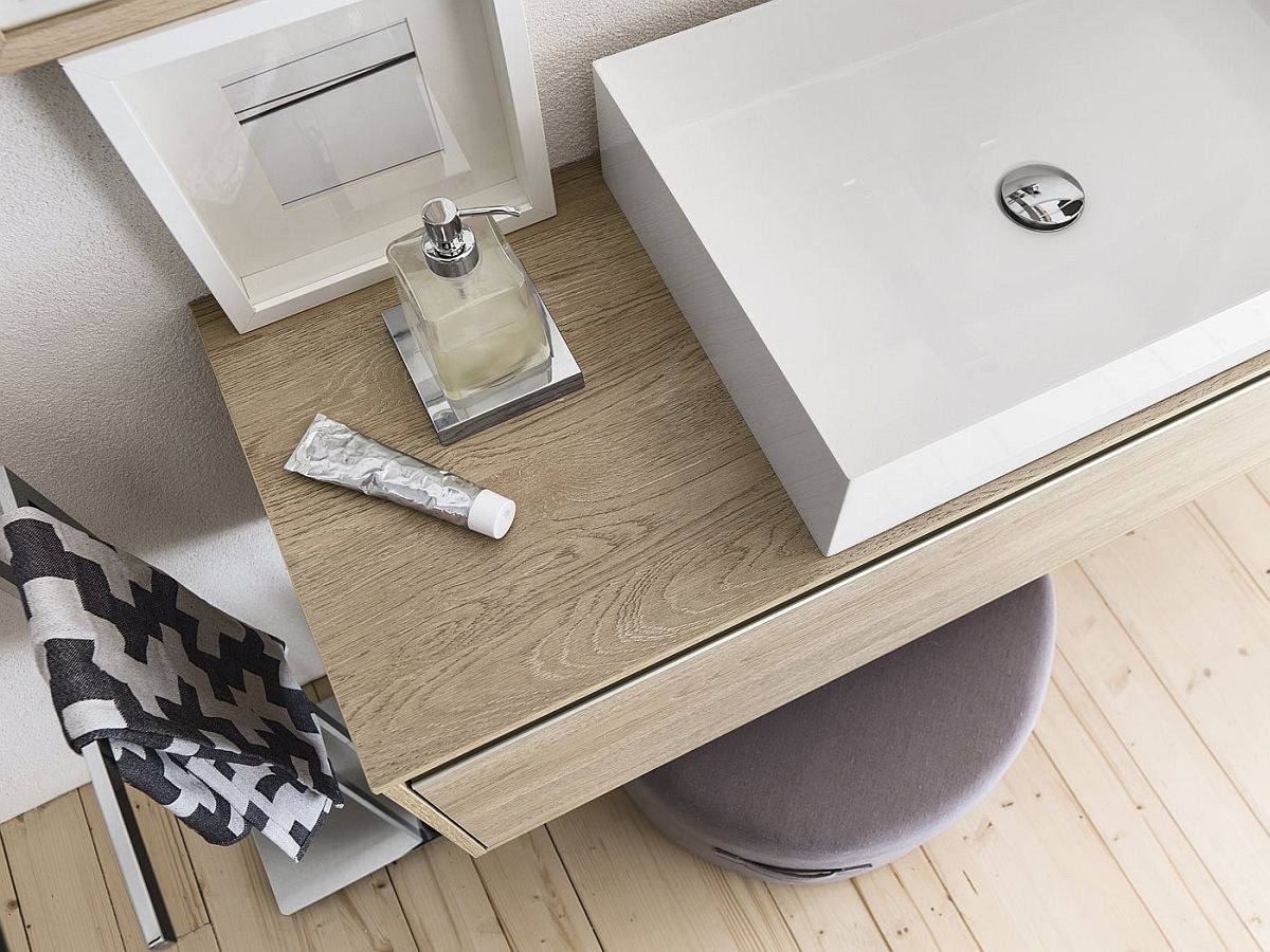 Wooden vanity series provides textural contrast to the modern bathroom